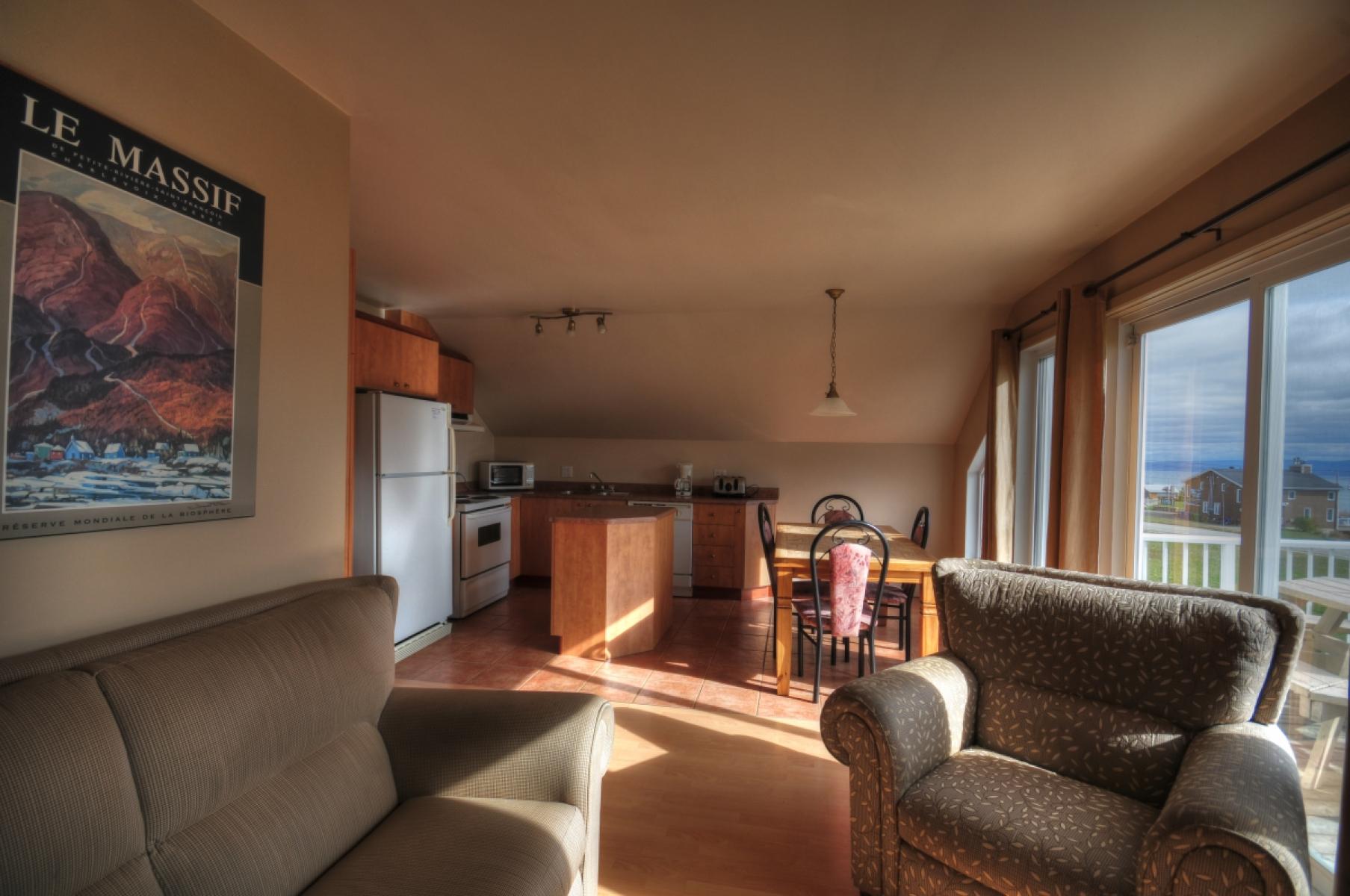 Chalet louer le pied de vent loft prestige charlevoix for Aire ouverte cuisine salon