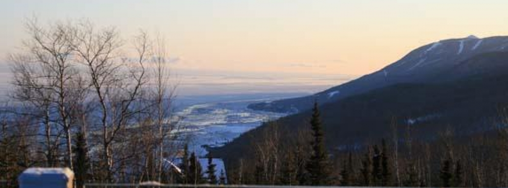 Winter view of the river and Massif Charlevoix's ski runs