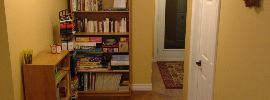 Bookshelf with books and boardgames